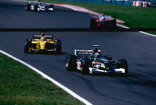 2002 Hungarian Grand Prix.Hungaroring, Budapest, Hungary. 16-18 August 2002.Eddie Irvine (Jaguar R3) followed by Takuma Sato (Jordan EJ12 Honda).Ref-02 HUN 28.World Copyright - Coates/LAT Photographic
