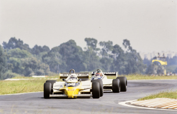 Alain Prost, Renault RE20B, leads Hector Rebaque, Brabham BT49C Ford.