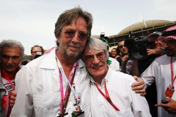 Eric Clapton (GBR) Guitar legend (Left) Bernie Ecclestone (GBR) F1 Supremo. Formula One World Championship, Rd 3, Bahrain Grand Prix, Race, Bahrain International Circuit, Bahrain, Sunday 6 April 2008.  BEST IMAGE