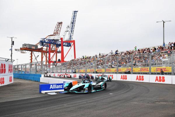 Sam Bird (GBR), Jaguar Racing, Jaguar I-TYPE 5, leads Mitch Evans (NZL), Jaguar Racing, Jaguar I-TYPE 5, and Nick Cassidy (NZL), Envision Virgin Racing, Audi e-tron FE07