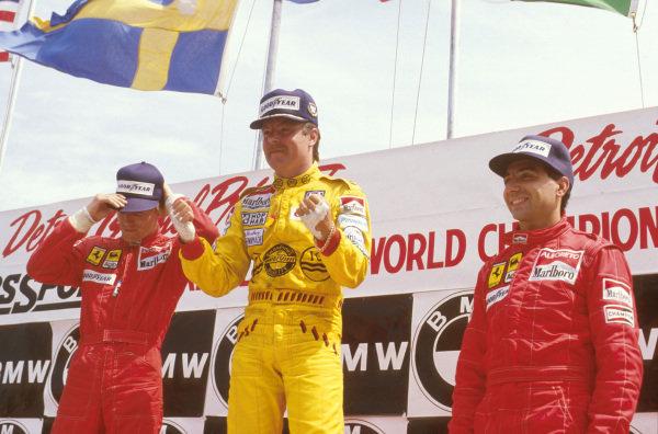 Detroit, Michigan, USA.21-23 June 1985.Keke Rosberg (Williams Honda) 1st position, Sefan Johansson 2nd position and Michele Alboreto 3rd position (both Ferrari) on the podium.Ref-85 USA 09.World Copyright - LAT Photographic