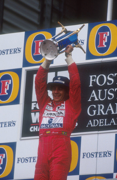 1991 Australian Grand Prix.Adelaide, Australia.1-3 November 1991.Ayrton Senna (McLaren Honda) celebrates 1st position on the podium.Ref-91 AUS 25.World Copyright - LAT Photographic