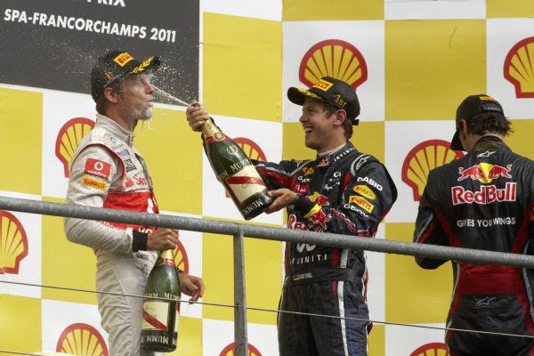 Sebastian Vettel, 1st position, celebrates on the podium with Mark Webber, 2nd position, and Jenson Button, 3rd position.