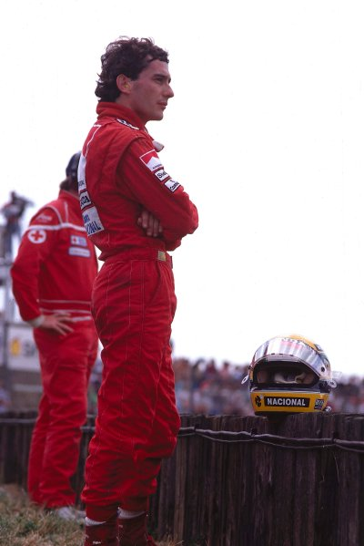 1989 British Grand Prix.Silverstone, England.14-16 July 1989.Ayrton Senna (McLaren Honda) watches from the track side after his retirement from the race.Ref-89 GB 24.World Copyright - LAT Photographic