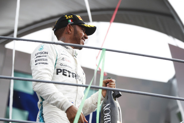 Lewis Hamilton, Mercedes AMG F1, 1st position, on the podium with his Champagne.