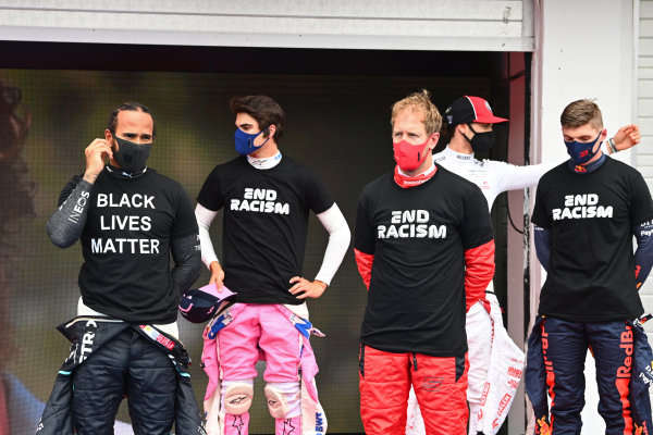 Lewis Hamilton, Mercedes-AMG Petronas F1, Lance Stroll, Racing Point, Sebastian Vettel, Ferrari, and Max Verstappen, Red Bull Racing, stand in support of the End Racism campaign