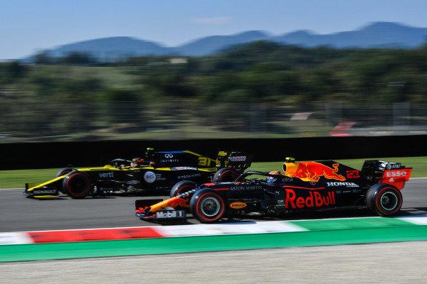 Esteban Ocon, Renault R.S.20, leads Alexander Albon, Red Bull Racing RB16