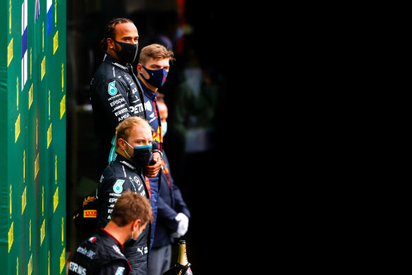 Valtteri Bottas, Mercedes-AMG Petronas F1, 2nd position, Lewis Hamilton, Mercedes-AMG Petronas F1, 1st position, and Max Verstappen, Red Bull Racing, 3rd position, on the podium