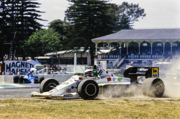 Teo Fabi, Toleman TG185 Hart, kicks up dirt after going off the circuit.