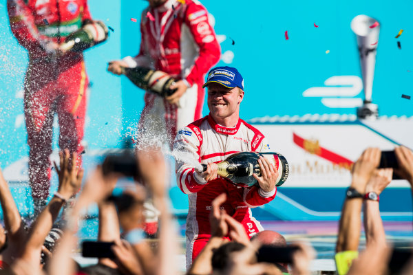 2016/2017 FIA Formula E Championship. Round 7 - Berlin ePrix, Tempelhof Airport, Berlin, Germany. Saturday 10 June 2017. Felix Rosenqvist (SWE), Mahindra Racing, Spark-Mahindra, Mahindra M3ELECTRO, sprays the champagne on the podium. Photo: Zak Mauger/LAT/Formula E ref: Digital Image _54I7705