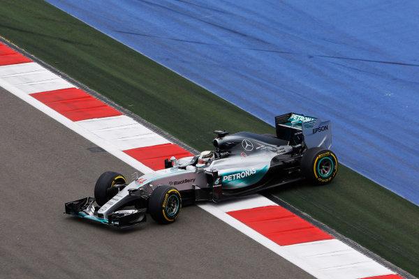 Sochi Autodrom, Sochi, Russia. Friday 9 October 2015. Lewis Hamilton, Mercedes F1 W06 Hybrid spins off the track. World Copyright: Charles Coates/LAT Photographic ref: Digital Image _J5R9911