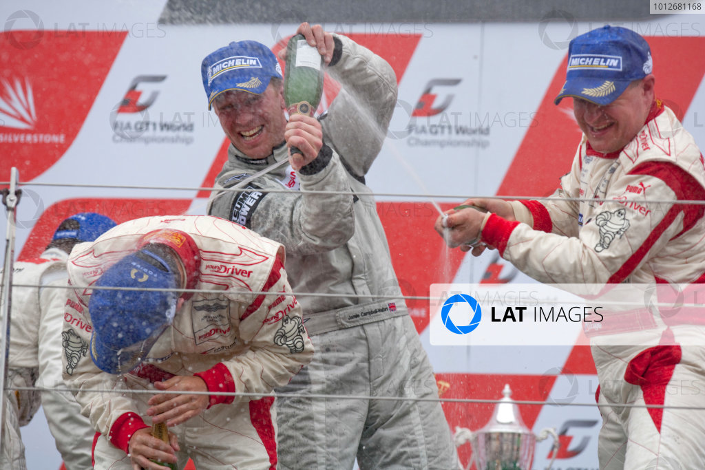 Silverstone, England. 30th April - 2nd May 2010.Darren Turner / Tomas Enge, (Young Driver AMR, Aston Martin DB9) celebrate their victory on the podium. World Copyright: Alastair Staley/LAT PhotographicRef: _P9O2651 jpg