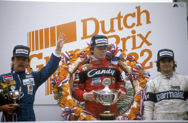 Zandvoort, Holland.1-3 July 1982.Didier Pironi (Ferrari) 1st position, Nelson Piquet (Brabham BMW) 2nd position and Keke Rosberg (Williams Ford) 3rd position on the podium.Ref-82 HOL 11.World Copyright - LAT Photographic