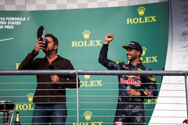 Circuit of the Americas, Austin Texas, USA. Sunday 23 October 2016. Gerard Butler drinks from the shoe of Daniel Ricciardo, Red Bull Racing, 3rd Position, on the podium. World Copyright: Sam Bloxham/LAT Photographic ref: Digital Image _SLA2693_1