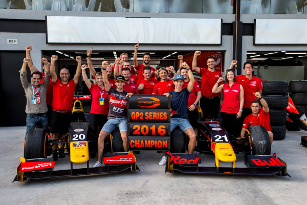 2016 GP2 Series Round 10. Sepang International Circuit, Sepang, Kuala Lumpur, Malaysia. Sunday 2 October 2016. Antonio Giovinazzi (ITA, PREMA Racing) and Pierre Gasly (FRA, PREMA Racing) celebrate winning the GP2 Series 2016 Team Championship with their team. Photo: Zak Mauger/GP2 Series Media Service. ref: Digital Image _X0W8965