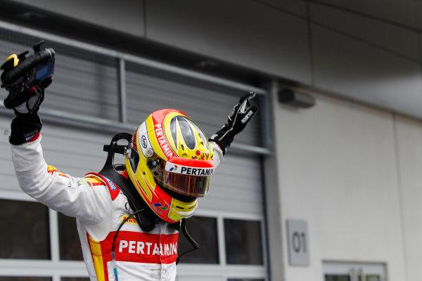 2015 GP2 Series Round 4.  Red Bull Ring, Spielberg, Austria.  Sunday 21 June 2015. Rio Haryanto (INA, Campos Racing) celebrates his win in Parc Ferme. Photo: Sam Bloxham/GP2 Media Service ref: Digital Image _G7C6400