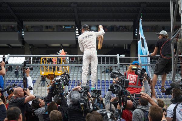 Red Bull Ring, Spielberg, Austria. Sunday 21 June 2015. Nico Rosberg, Mercedes AMG, 1st Position, celebrates with fans. World Copyright: Steve Etherington/LAT Photographic. ref: Digital Image SNE14934