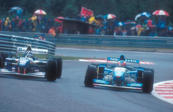 1995 Belgian Grand Prix. Spa-Francorchamps, Belgium. 25-27 August 1995. Damon Hill (Williams FW17 Renault) battles with Michael Schumacher (Benetton B195 Renault). Ref-95 BEL 09. World Copyright - LAT Photographic