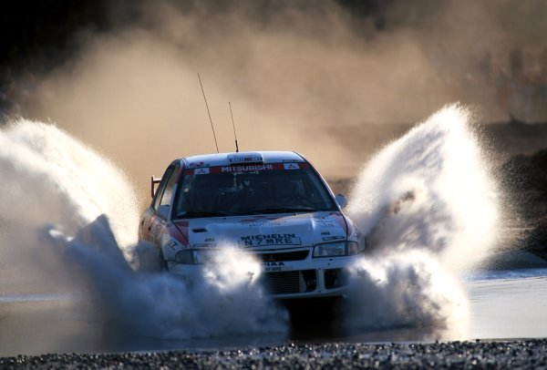 Fourth placed Richard Burns (GBR) Mitsubishi Lancer R6-E3 with co-driver Robert Reid (GBR) breeze through one of the water splashes.