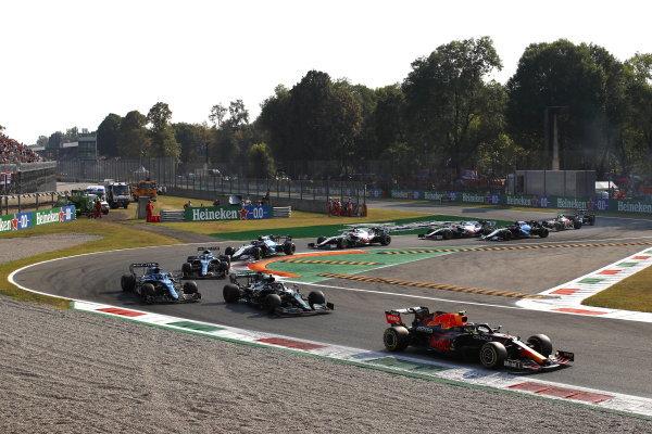 Sergio Perez, Red Bull Racing RB16B, leads Sebastian Vettel, Aston Martin AMR21, and Fernando Alonso, Alpine A521