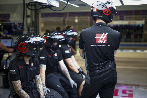 Haas F1 pit crew in the pit lane