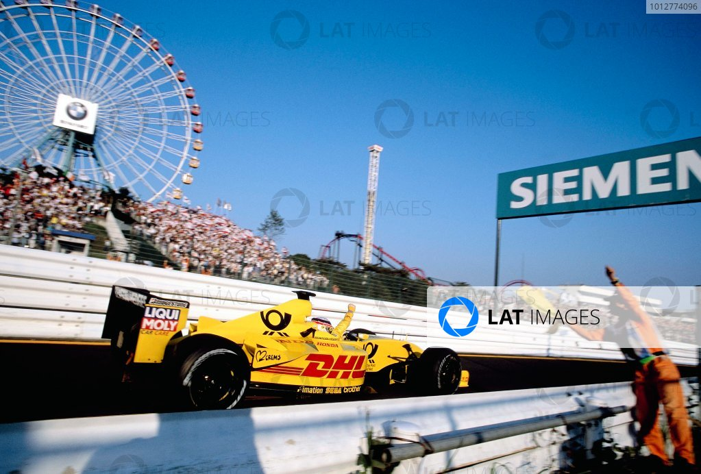 2002 Japanese Grand Prix.Suzuka, Japan. 11-13 October 2002.Takuma Sato (Jordan EJ12 Honda) 5th position, celebrates his first points of the season in his home Grand Prix.World Copyright - Steven Tee/LAT Photographicref: 35mm Image 02_Jap_03(60MB Jpeg Image, also available as 60MB Tiff on request)