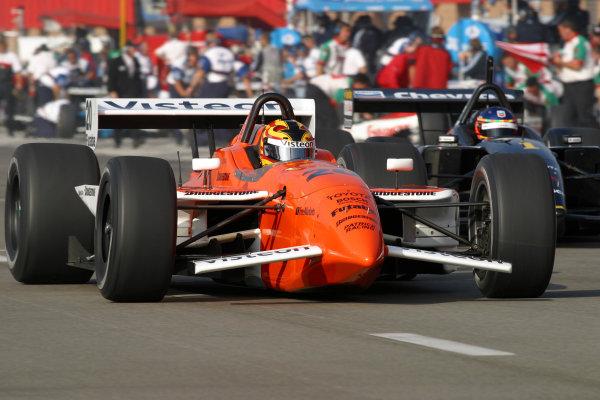 2002 Fontana CART, California Speedway, USA, 3 November, 2002Servia races da Matta out of the pits.-2002, Michael L. Levitt, USALAT Photographic