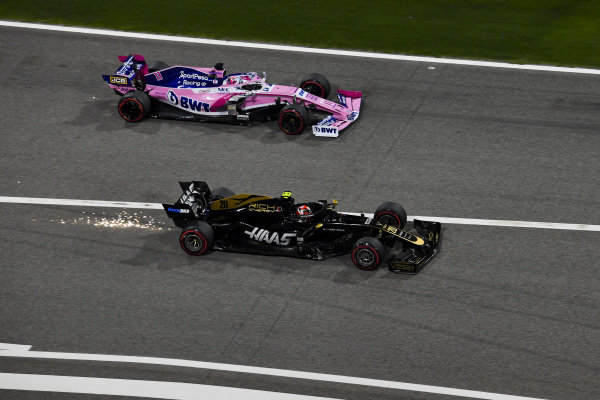 Sergio Perez, Racing Point RP19 and Kevin Magnussen, Haas VF-19