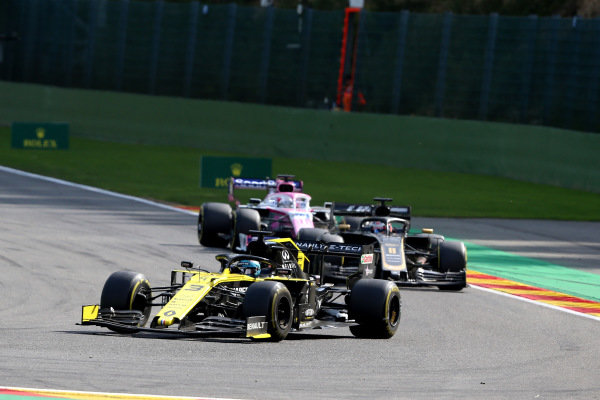 Daniel Ricciardo, Renault R.S.19, leads Romain Grosjean, Haas VF-19, and Sergio Perez, Racing Point RP19
