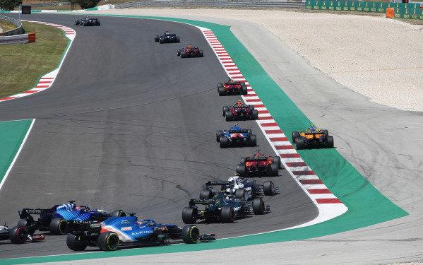 Valtteri Bottas, Mercedes W12, leads Sir Lewis Hamilton, Mercedes W12, Max Verstappen, Red Bull Racing RB16B, Carlos Sainz, Ferrari SF21, Sergio Perez, Red Bull Racing RB16B, Esteban Ocon, Alpine A521, and Lando Norris, McLaren MCL35M