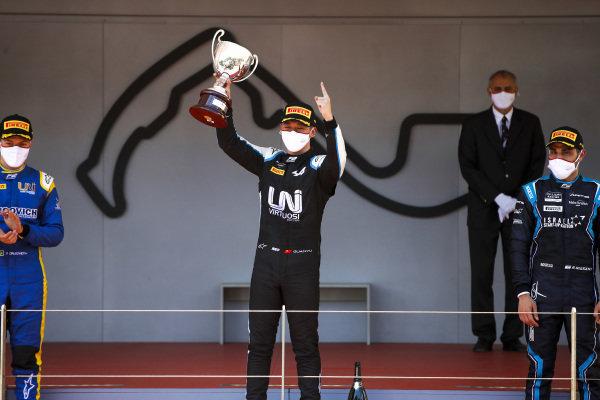 Felipe Drugovich (BRA, Uni-Virtuosi), Race Winner Guanyu Zhou (CHN, Uni-Virtuosi Racing) and Roy Nissany (ISR, DAMS) celebrate on the podium with the trophy