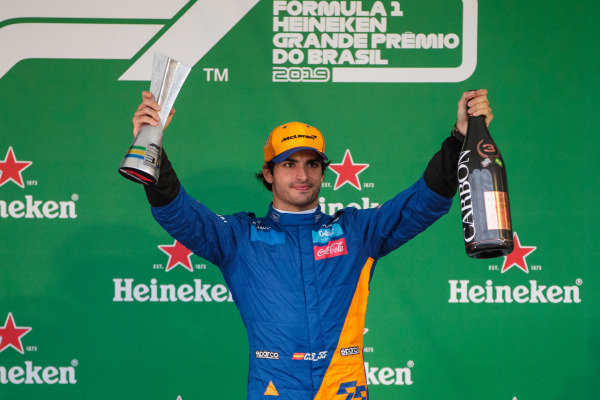 Carlos Sainz Jr, McLaren celebrates his third position on the podium with the trophy
