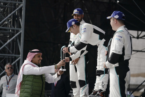 PRO AM class race winner Zhang Yaqi (CHI), Jaguar China Racing receives his trophy on the podium