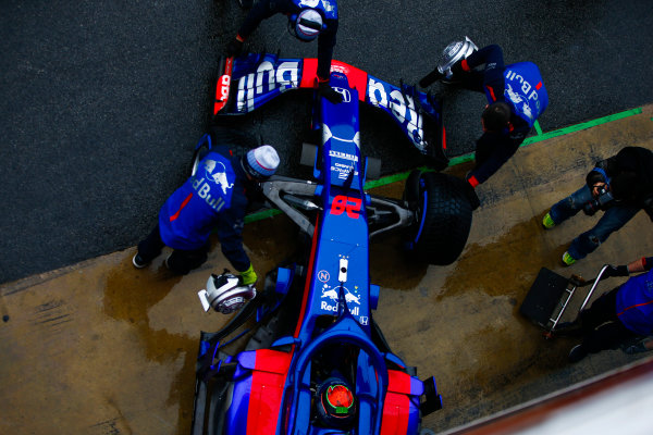 Circuit de Catalunya, Barcelona, Spain. Wednesday 28 February 2018. Brendon Hartley, Toro Rosso STR13 Honda, is pushed by mechanics into his pit garage. World Copyright: Andy Hone/LAT Images ref: Digital Image _ONZ9741