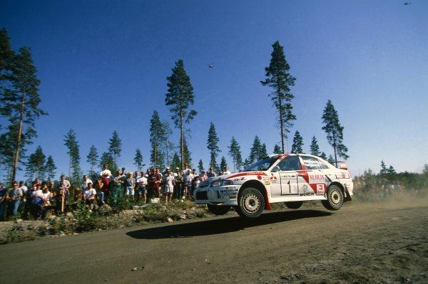1997 World Rally Championship.1000 Lakes Rally, Finland. 29-31 August 1997.Tommi Makinen/Seppo Harjanne (Mitsubishi Lancer Evo4), 1st position.World Copyright: Hardwick/LAT PhotographicRef: 35mm transparency 97RALLY07