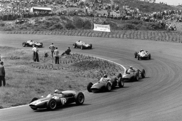 1960 Dutch Grand Prix Zandvoort, Holland. 6 June 1960 Bruce McLaren, Cooper T53-Climax, retired, leads Dan Gurney, BRM P48, retired, Jo Bonnier, BRM P48, retired, Chris Bristow, Cooper T51-Climax, retired, Richie Ginther, Ferrari Dino 246, 6th position, and Graham Hill, BRM P48, 3rd position, action World Copyright: LAT PhotographicRef: Autosport b&w print. Published: Autosport, 10/6/1960 p794