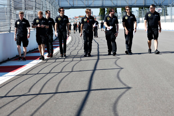 Sochi Autodrom, Sochi, Russia. Thursday 8 October 2015. Jolyon Palmer, Test and Reserve Driver, Lotus F1, and Romain Grosjean, Lotus F1, walks the track with engineers. World Copyright: Alastair Staley/LAT Photographic ref: Digital Image _79P8696
