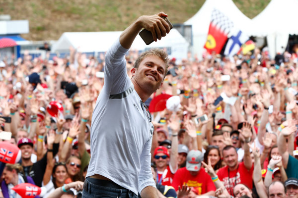 Hockenheim, Germany. Saturday 30 July 2016. Nico Rosberg, Mercedes AMG, takes a photo in front of an enthusiastic crowd. World Copyright: Andy Hone/LAT Photographic ref: Digital Image _ONY7771