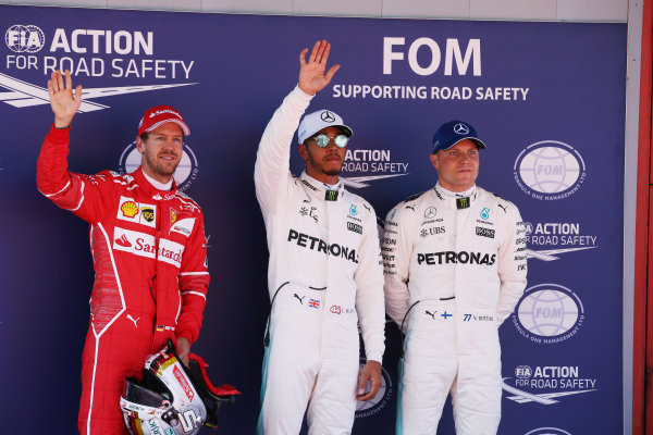 Circuit de Catalunya, Barcelona, Spain. Saturday 13 May 2017. Top three qualifiers Lewis Hamilton, Mercedes AMG, Sebastian Vettel, Ferrari, and Valtteri Bottas, Mercedes AMG. World Copyright: Charles Coates/LAT Images ref: Digital Image DJ5R8889
