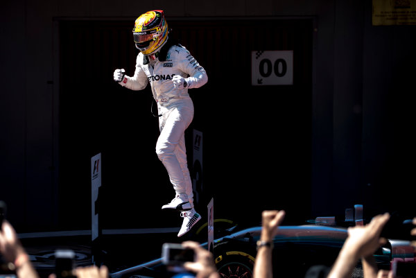 Circuit de Catalunya, Barcelona, Spain. Sunday 14 May 2017. Lewis Hamilton, Mercedes F1 W08 EQ Power+, jumps from his car after winning the race. World Copyright: Glenn Dunbar/LAT Images ref: Digital Image _31I6238