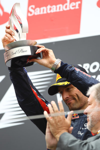 Nurburgring, Germany.24th July 2011Mark Webber, Red Bull Racing RB7 Renault, 3rd position, lifts his trophy. Portrait. Podium. World Copyright: Andy Hone/LAT Photographicref: Digital Image CSP13472