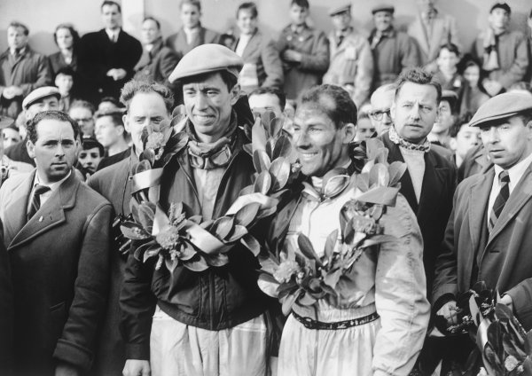 Dundrod, Northern Ireland. 17th September 1955.Stirling Moss / John Fitch (Mercedes-Benz 300SLR), 1st position, with the winning laurels, portrait. World Copyright: LAT Photographic.Ref:  Autocar Glass Plate C44735.