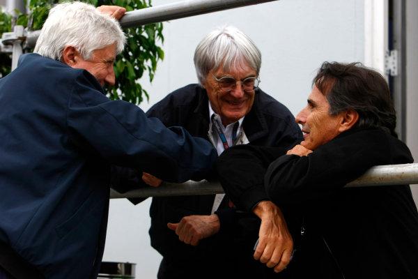 Interlagos, Sao Paulo, Brazil.16th October 2009.Bernie Ecclestone with Herbie Blash, FIA, and Nelson Piquet. Portrait. World Copyright: Charles Coates/LAT Photographicref: Digital Image _26Y9462