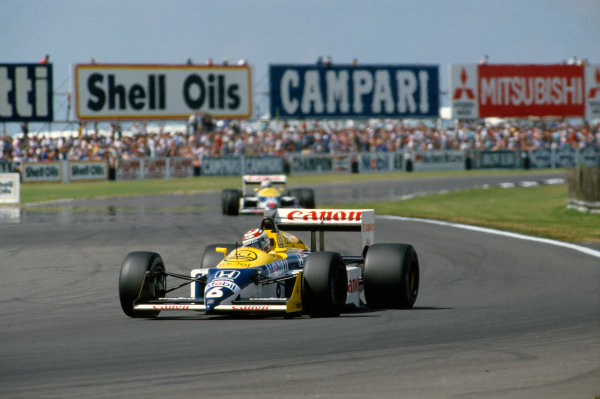 Silverstone, England.10-12 July 1987.Nelson Piquet leads Nigel Mansell (both Williams FW11B Honda's), action.World Copyright - LAT Photographic