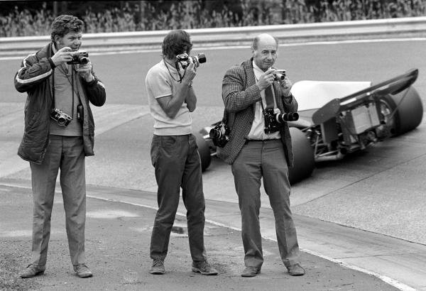 British Photographers, L to R: Maurice Rowe, Laurie Morton, and Geoff Goddard at the famous Karussell corner during practice