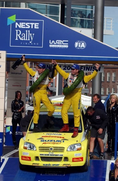 Daniel Carlsson (SWE), right, and co-driver Mattias Andersson (SWE), left, celebrate victory in the Super 1600 Championship on 2003 Rally Finland. FIA World Rally Championship, Rd9, Neste Rally Finland, Jyvaskyla, Finland. Day 3, 10 August 2003.DIGITAL IMAGE