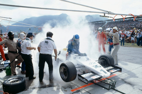 Jacarepagua, Rio De Janeiro, Brazil.11-13 March 1983.Keke Rosberg (Williams FW08C Ford) during a disastrous pitstop, where a small amount of spilt fuel caused a flash-fire which was promptly extinguished by marshals. He returned to his cockpit to finish 2nd but was disqualified for a push start after this stop.Ref-83 BRA 06.World Copyright - LAT Photographic