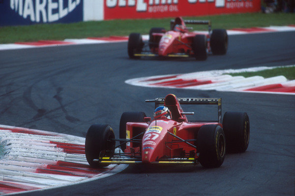 Monza, Italy.8-10 September 1995.Jean Alesi leads teammate Gerhard Berger (both Ferrari 412T2's) through the Rettifilo Chicane. He exited the race after his rear wheel bearing failed. Ref-95 ITA 04.World Copyright - LAT Photographic