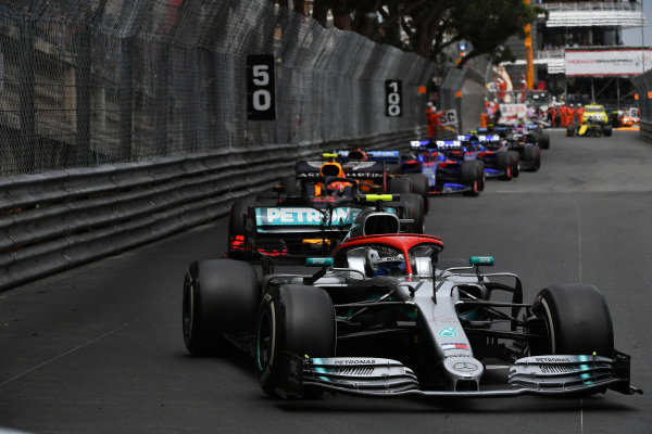 Valtteri Bottas, Mercedes AMG W10, leads Pierre Gasly, Red Bull Racing RB15, Carlos Sainz Jr., McLaren MCL34, and Daniil Kvyat, Toro Rosso STR14