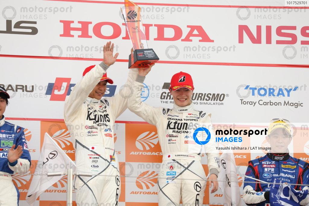 GT300 Winner Morio Nitta & Sena Sakaguchi, LM Corsa K-Tunes Racing Lexus RC F GT3, raise their trophy on the podium